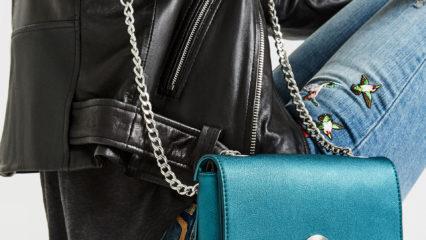 Si buscas un bolso diferente, echa un vistazo a este diseño de bandolera personalizable que Incluye una segunda solapa intercambiable de modo sencillo. Un bolso con cadena y cierre metálico. En el interior, tiene tres compartimentos diferenciados.